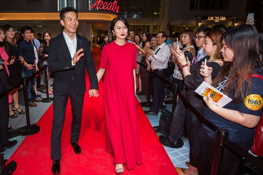 Joanne Peh, with actor-husband Qi Yuwu, on the red carpet at the premiere of movie 1965 on July 28.