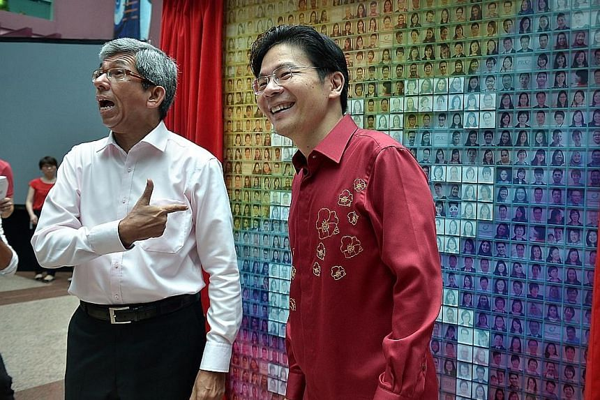 Dr Yaacob Ibrahim with Mr Lawrence Wong during the unveiling of the SG50 Mural Wall at the joint National Day Observance Ceremony held at the Old Hill Street Police Station yesterday.