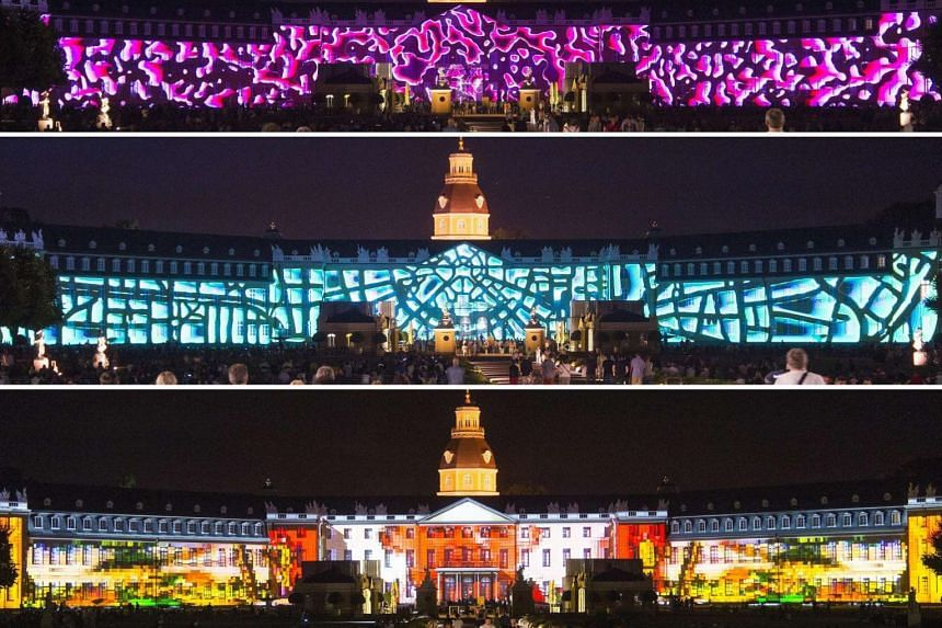 A series of panoramic views of the Karlsruhe Palace in south-western Germany during a show on Wednesday as part of the city's 300th- anniversary celebration. The light show, which portrays the transformation of the palace facade over the years, will