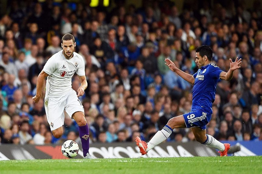 Fiorentina's Mario Suarez (left) and Chelsea's Radamel Falcao vying for the ball. The Colombian's insipid performance has compounded Jose Mourinho's problems.