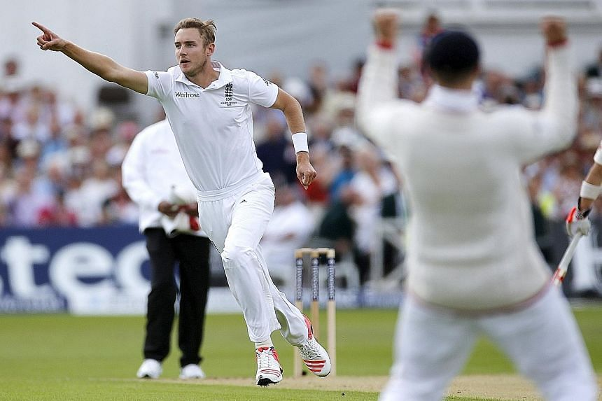 England's Stuart Broad celebrating his dismissal of Australia's Chris Rogers, his 300th Test scalp. He went on to claim seven more wickets, as Australia collapsed to 60 all out well before lunch on day one at Trent Bridge.