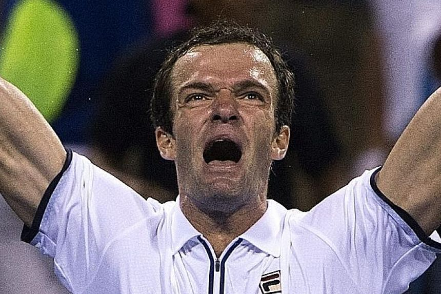 A beleaguered Andy Murray (top) after losing a point to Russian Teymuraz Gabashvili. The Briton is the first top seed at the Washington Open to lose his opening match since 1993.
