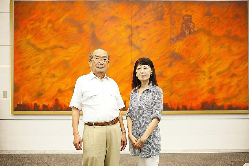 War survivor Hiromi Hasai with Ms Ritsuko Kinoshita, who has spent years by his side as he addressed visitors to Hiroshima's Peace Memorial Museum.