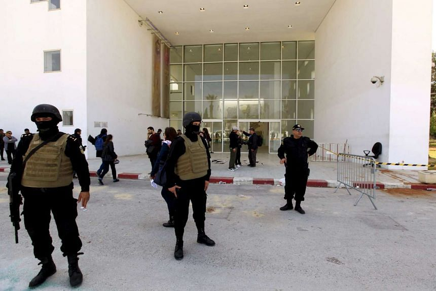 Tunisian police officers guard the entrance of the Bardo Museum in Tunis, in this March 19, 2015, file photo.