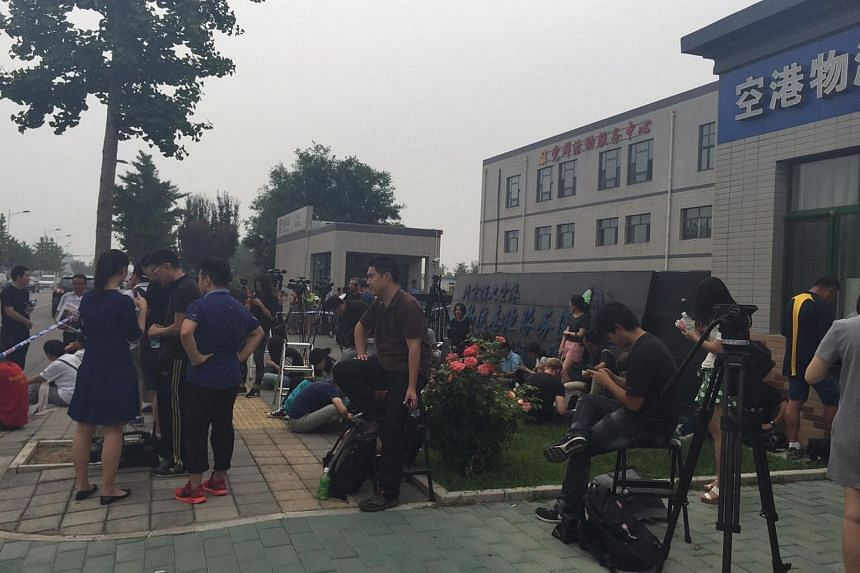 Chinese family members of those on board the missing MAS Flight MH370 gathering outside the family contact centre near Beijing airport on Friday.