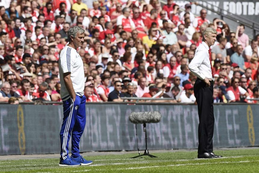 The squabble between managers Arsene Wenger (right) and Jose Mourinho is all part of the show, says Premier League boss Richard Scudamore.