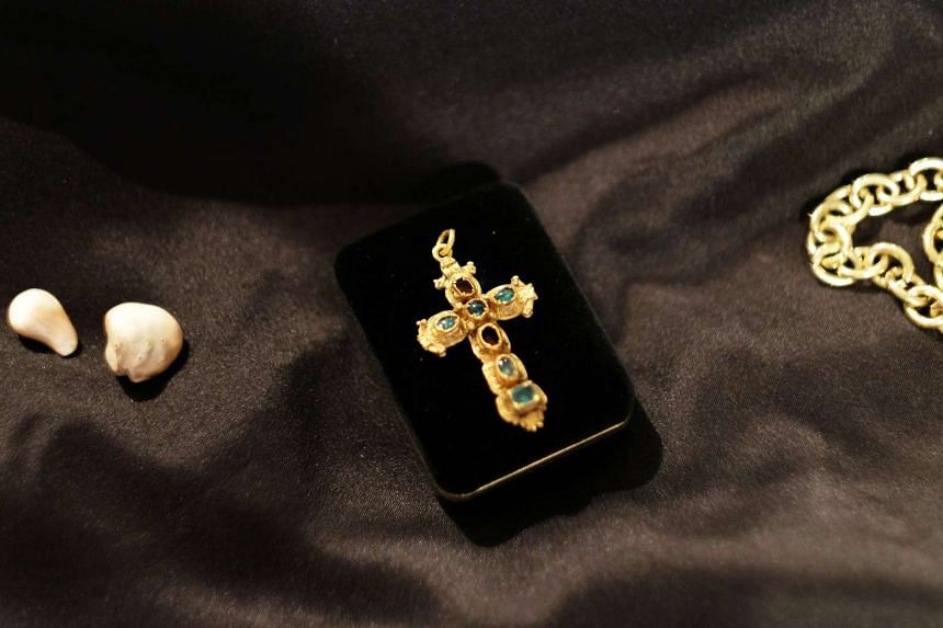 A gold crucifix - part of the treasure - on display in New York.