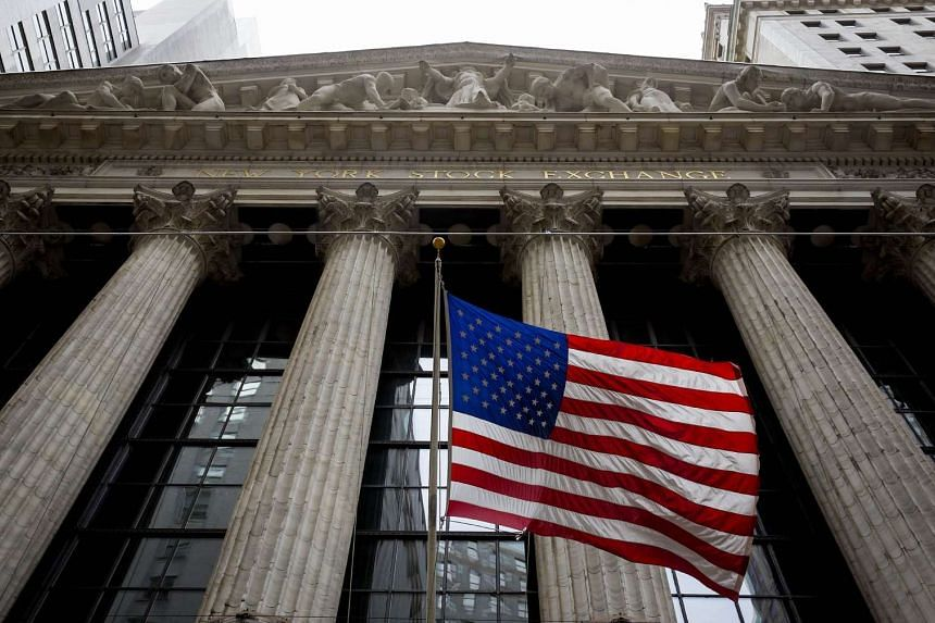 A file picture of the NY stock exchange. U.S. employment rose at a solid clip in July and wages rebounded, signs of an improving economy that could open the door wider to a Federal Reserve interest rate hike in September. PHOTO: AFP
