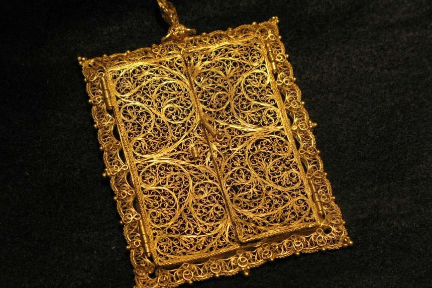 A gold frame - part of the treasure - on display in New York.