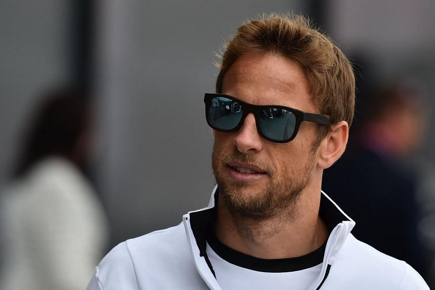 Jenson Button walking in the paddock before the British Formula One Grand Prix.