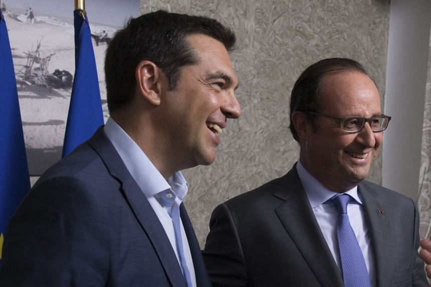 French President Francois Hollande (right) and Greek Prime Minister Alexis Tsipras meet in Ismailia, Egypt.