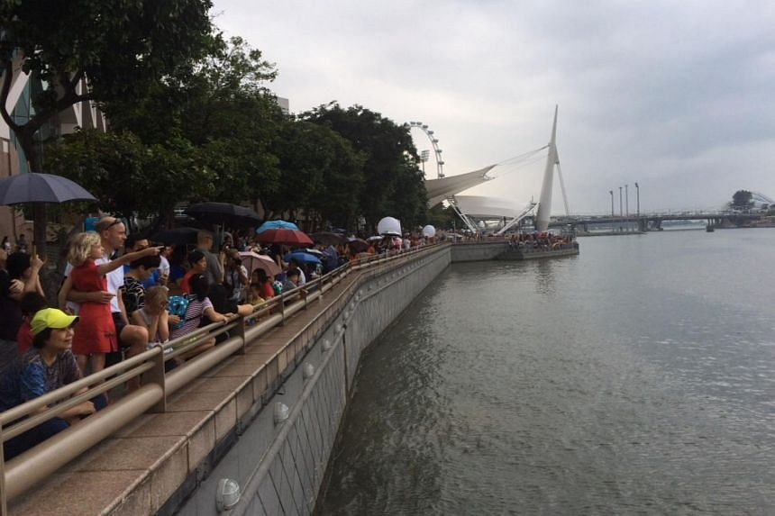The crowd at Jubilee Walk braving the rain to watch the Black Knights on Aug 7, 2015.
