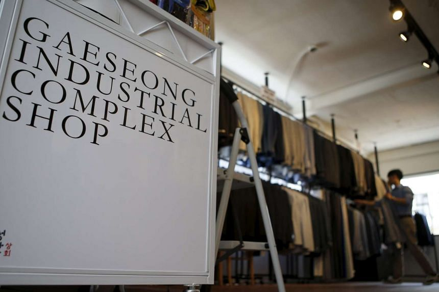 An employee arranges jackets at a store selling goods from the inter-Korean Kaesong Industrial Complex in North Korea, in Seoul, South Korea on Aug 6, 2015