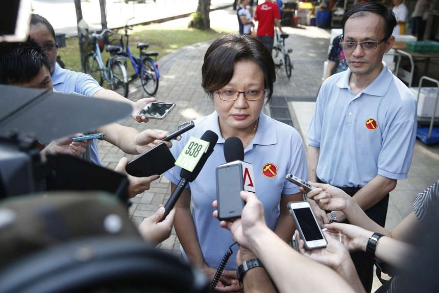 Workers' Party chairman Sylvia Lim speaks to the media during a walkabout at Macpherson Market and Food Centre on Aug 7, 2015.
