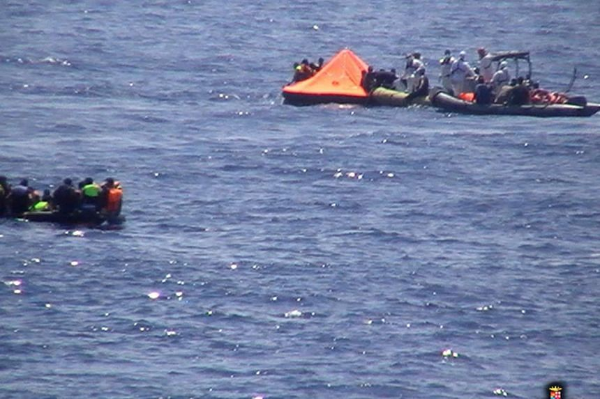 Crew of the Italian navy destroyer Mimbelli rescuing survivors at the site where a boat carrying over 600 migrants capsized in the Mediterranean.
