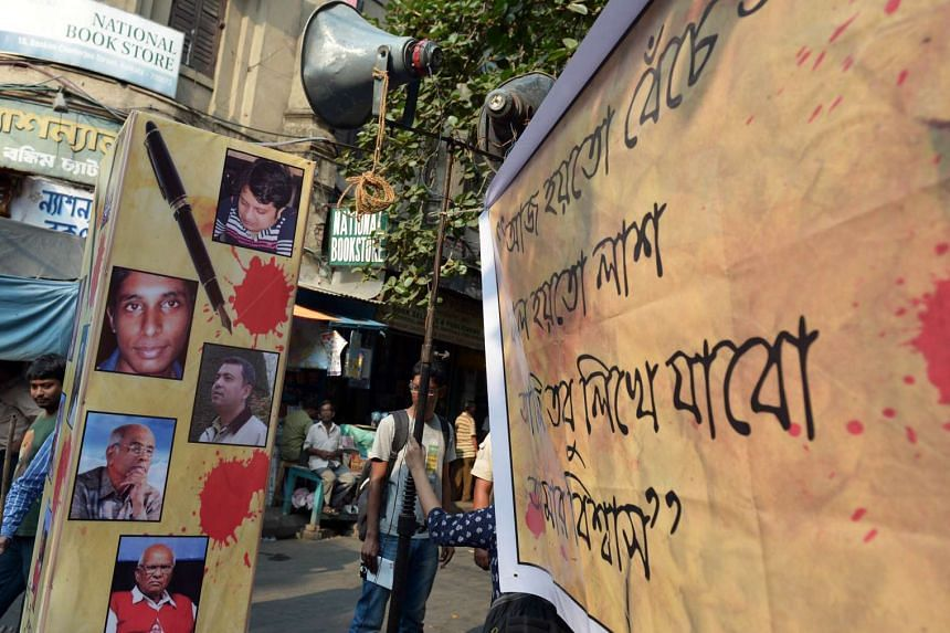 A poster with pictures of recently killed Bangladeshi bloggers during a protest meeting organised to pay homage on May 16, 2015.