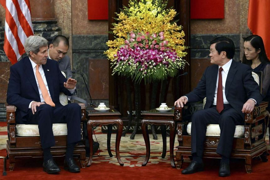 US Secretary of State John Kerry (left) during talks with Vietnamese president Truong Tan Sang (right) on Aug 7, 2015.