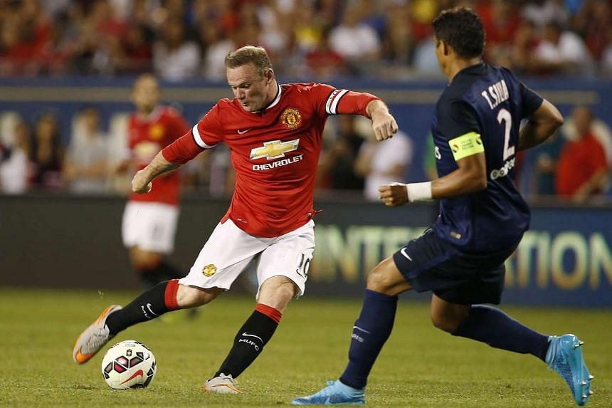 Manchester United forward Wayne Rooney against Paris Saint-Germain defender Thiago Silva during an International Champions Cup football match.