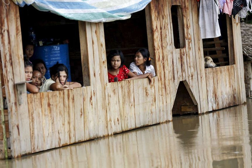 The talks come as Myanmar's government is battling floods that have killed scores of people and left more than 330,000 affected across the country.