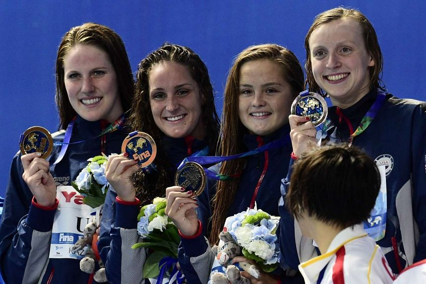 Missy Franklin, Leah Smith, Katie McLaughlin and Katie Ledecky celebrates their gold medal win.