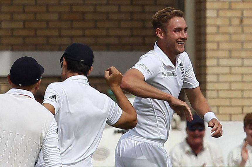 England bowler Stuart Broad (right) celebrates taking the wicket of Australia's Steven Smith on the first day of the fourth Ashes cricket test match between England and Australia on Aug 6, 2015.