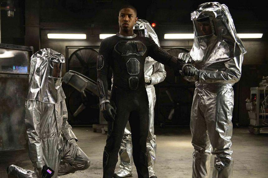 Michael B. Jordan as Johnny Storm in Fantastic Four.