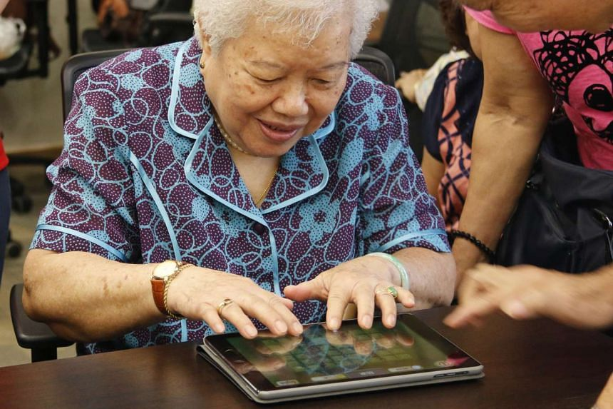 A woman playing a game developed by the NTU centre, designed to detect movement problems.