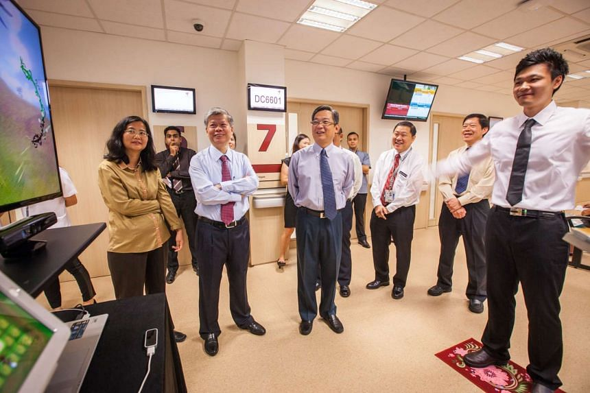 Front row, from left: Professor Miao Chun Yan, director of Nanyang Technological University (NTU)'s Research Centre of Excellence in Active Living for the Elderly, Prof Lam Khin Yong, NTU's chief of staff and vice-president of research, Mr Gan Ki