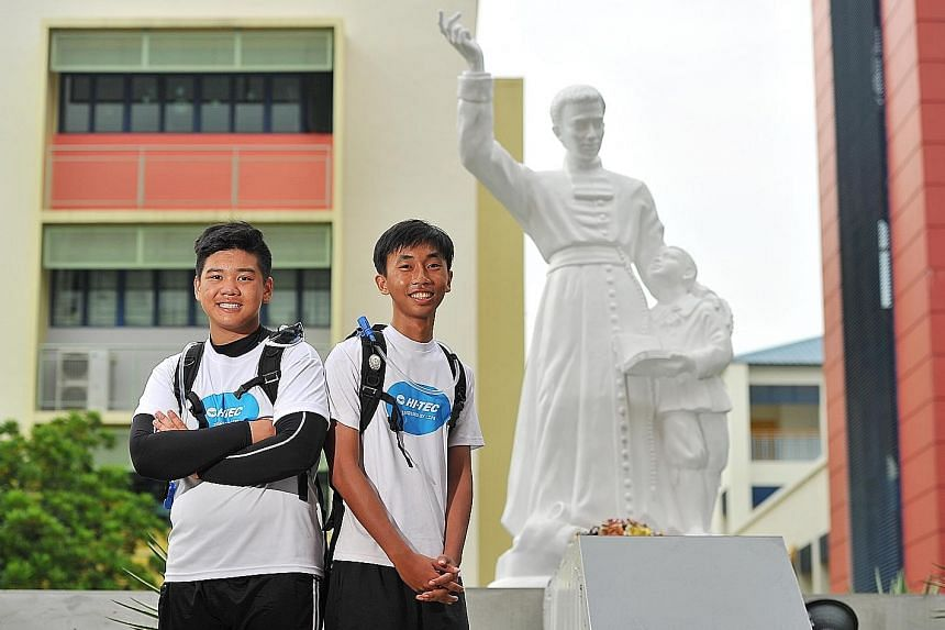 Students Ethan Teo (far left) and Jackies Low, members of the group that went on the 300km charity trek to mark 300 years of the international Catholic institution Brothers of St Gabriel. The institution set up six schools in Singapore.