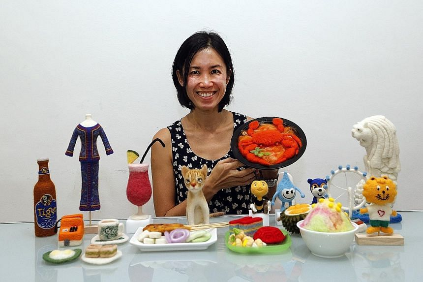 Ms Ng Hwee Hwee has created 50 wool sculptures of Singapore icons, including Tiger Beer, the Singapore Airlines kebaya, an orange payphone, the Kucinta, or Singapore cat, foods such as satay, chilli crab, durian, kueh and ice kachang, Teamy the Bee f