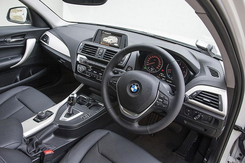 The new 116d's cockpit feels retro with its basic driving aids.