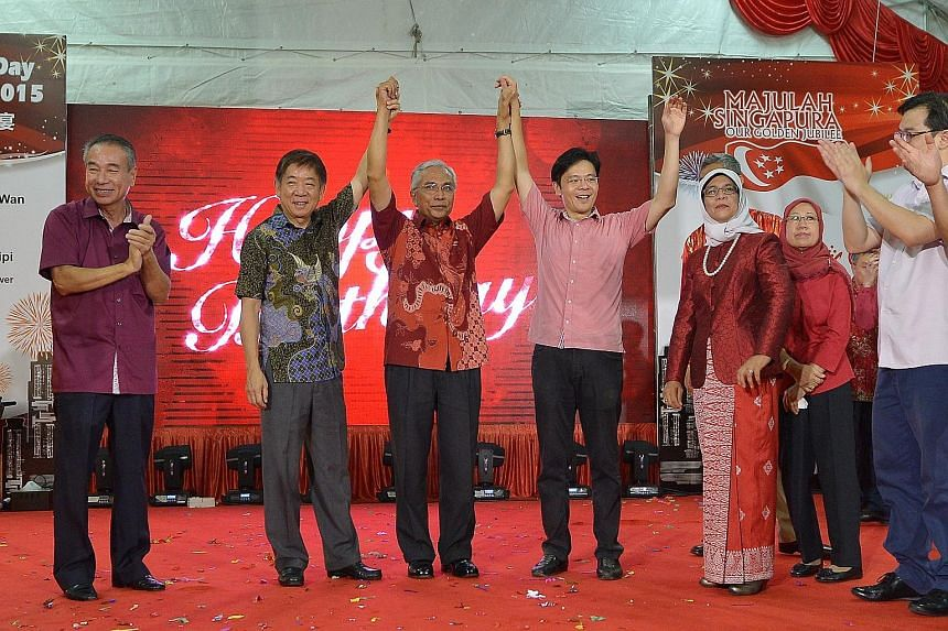From left: Sembawang GRC anchor minister Khaw Boon Wan, Mr Hawazi Daipi, Culture, Community and Youth Minister Lawrence Wong, Speaker of Parliament Halimah Yacob and Mr Hawazi's wife, Madam Essah Hussain, at the Marsiling National Day dinner yesterda