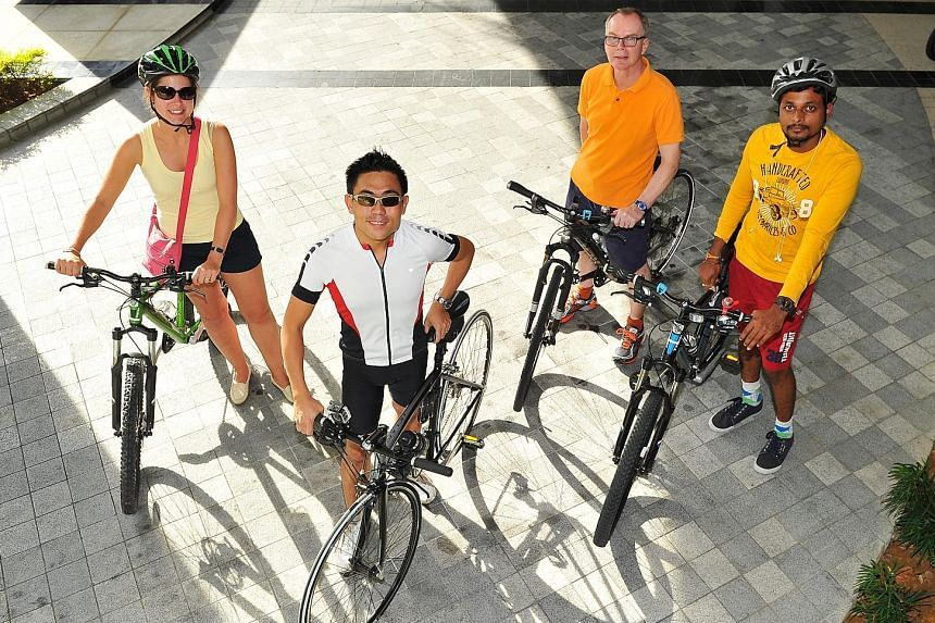 Capri by Fraser's general manager Vernon Lee (in white) with hotel guests (from left) Rosemarijn Kriek, John Maxwell and Santosh Kumar Podishetti, 29, before they set off on their tour of the Changi area. Mr Lee conducts such free, informal cycling t