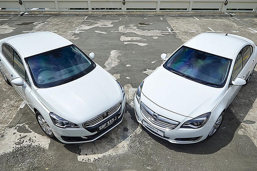 The Peugeot 508 (far left) and the Opel Insignia (left).