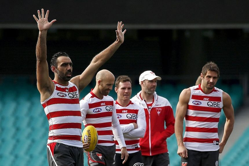 Aboriginal activist and Australian Rules football legend Adam Goodes (left) training with Sydney Swans teammates at the Sydney Cricket Ground on Tuesday. Goodes has been subject to relentless booing from rival Australian Rules crowds for months now.