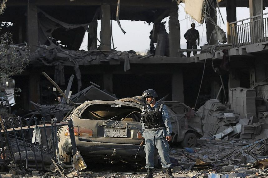 The force of the explosion in the neighbourhood of Shah Shaheed in Kabul yesterday reduced the front of nearby buildings to rubble. Officials were searching for anyone trapped under the debris, and said that the number of wounded could run into the h