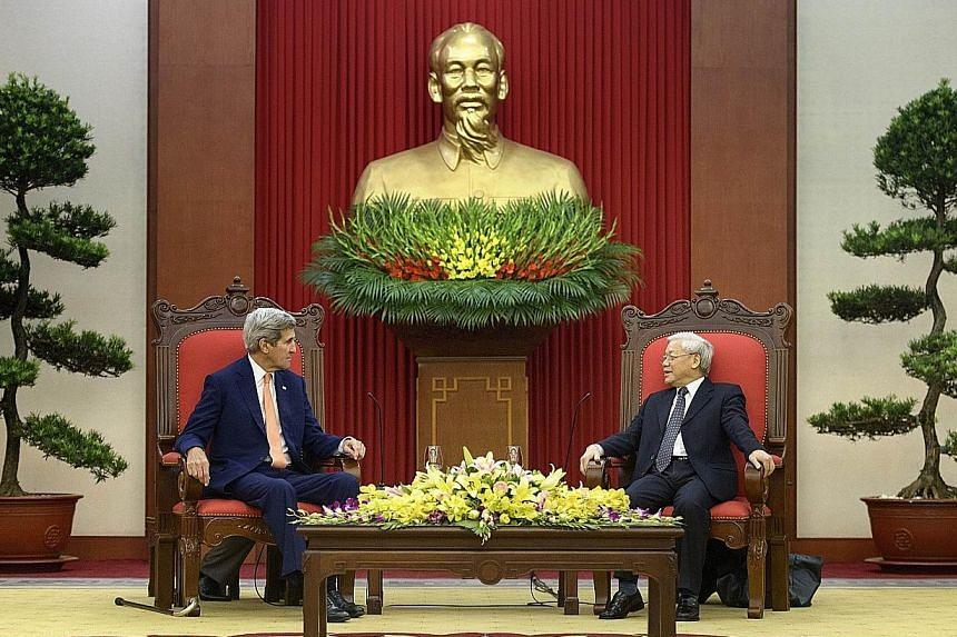 Mr Kerry (left) meeting Vietnam Communist Party general secretary Nguyen Phu Trong in Hanoi.