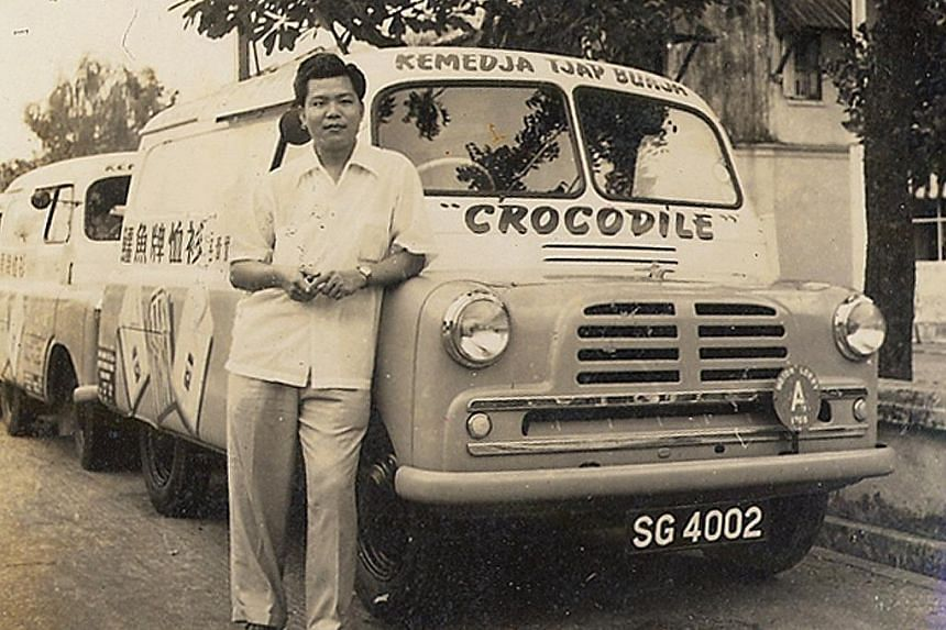 Mr Tan Hian Tsin now (above) and with Crocodile's vans in the company's early years (left). Mr Tan set up Crocodile with his brother in 1947, the year he came to Singapore.