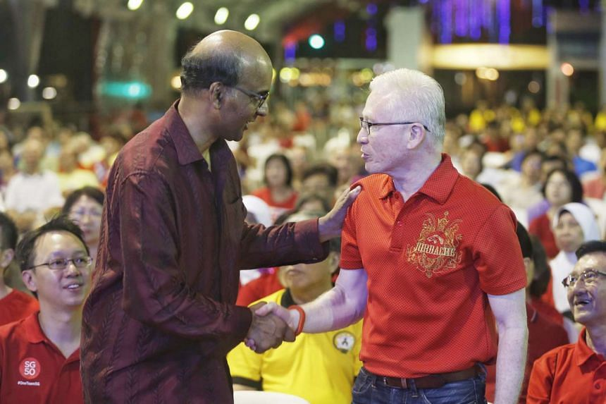 Deputy Prime Minister Tharman Shanmugaratnam (left) thanking Mr Arthur Fong, who announced his stepping down from politics.