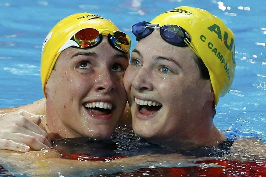 Bronte Campbell (left) celebrates with third-placed sister Cate at the women's 100m freestyle final.