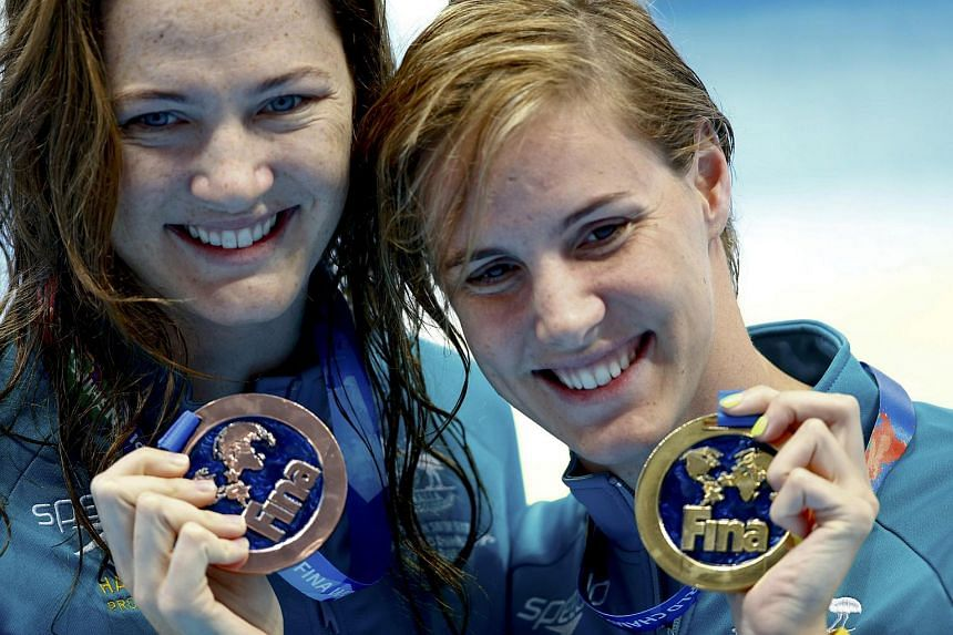 Bronte Campbell (right) and sister Cate showing their medals after the women's 100m freestyle final in Kazan, Russia.