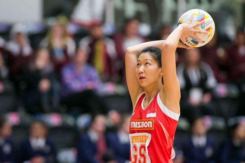 Singapore goal shooter Charmaine Soh attempts a shot in their preliminary round match against Sri Lanka.