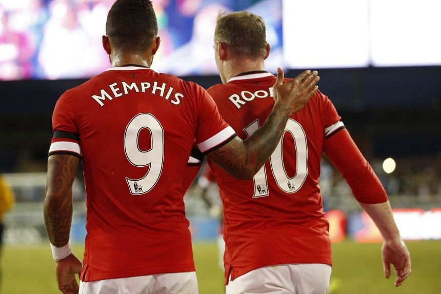 Manchester United's Memphis Depay is congratulated by teammate Wayne Rooney after scoring in a friendly.