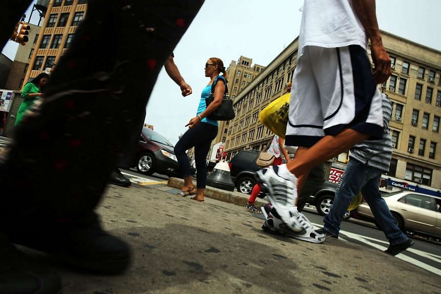 People walk in an area of the Bronx, which is the centre of the Legionnaires' disease outbreak.