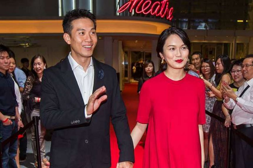 Qi Yuwu and Joanne Peh at the premiere of movie 1965 on July 28.