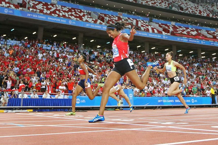 Shanti Pereira (centre) gave the home crowd plenty to scream about when she bagged gold in the 200m in the recent SEA Games.