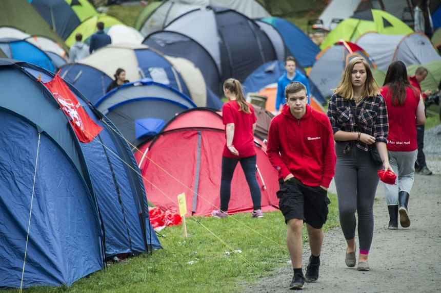 Young people from the Norwegian Labour Party's youth division (AUF) at Utoya island yesterday. It was the first AUF summer camp to be held there since 2011, when a right-wing extremist killed 69 people - mostly teenagers - on the island.