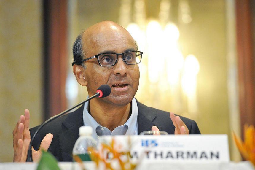 Deputy Prime Minister Tharman Shanmugaratnam speaking at an Institute of Policy Studies forum.