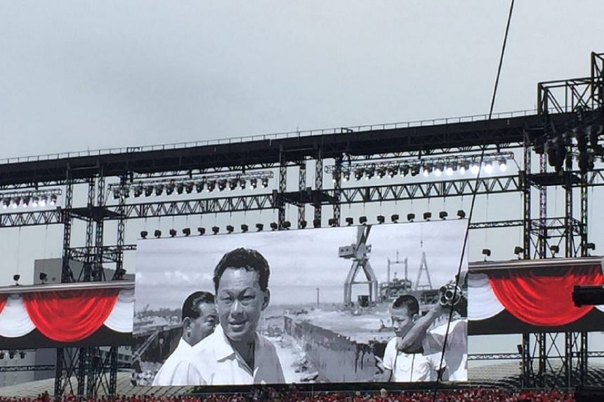 The mood turned solemn at the NDP as a tribute to Mr Lee Kuan Yew played.