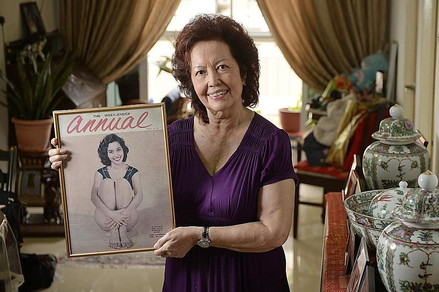 Mrs Marion Woodworth was the first Eurasian to win the Miss Singapore pageant, in 1958. She is holding a framed cover of Weekender magazine showing her as cover girl. Madam Ho's mother burnt her Miss Singapore sash during the Japanese Occupation. (Fa